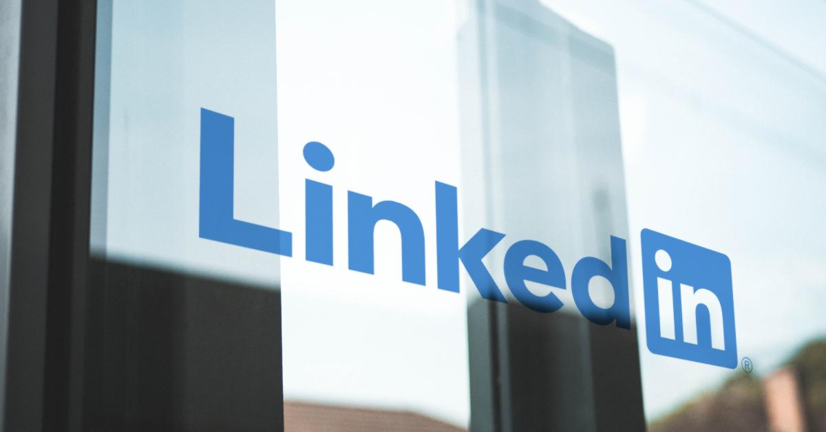 LinkedIn logo on a glass doorway.