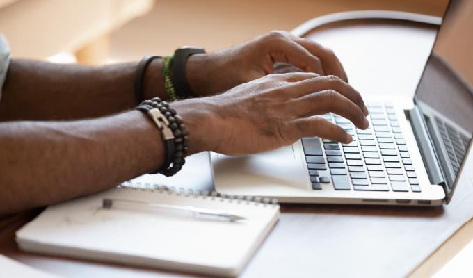 typing-at-laptop