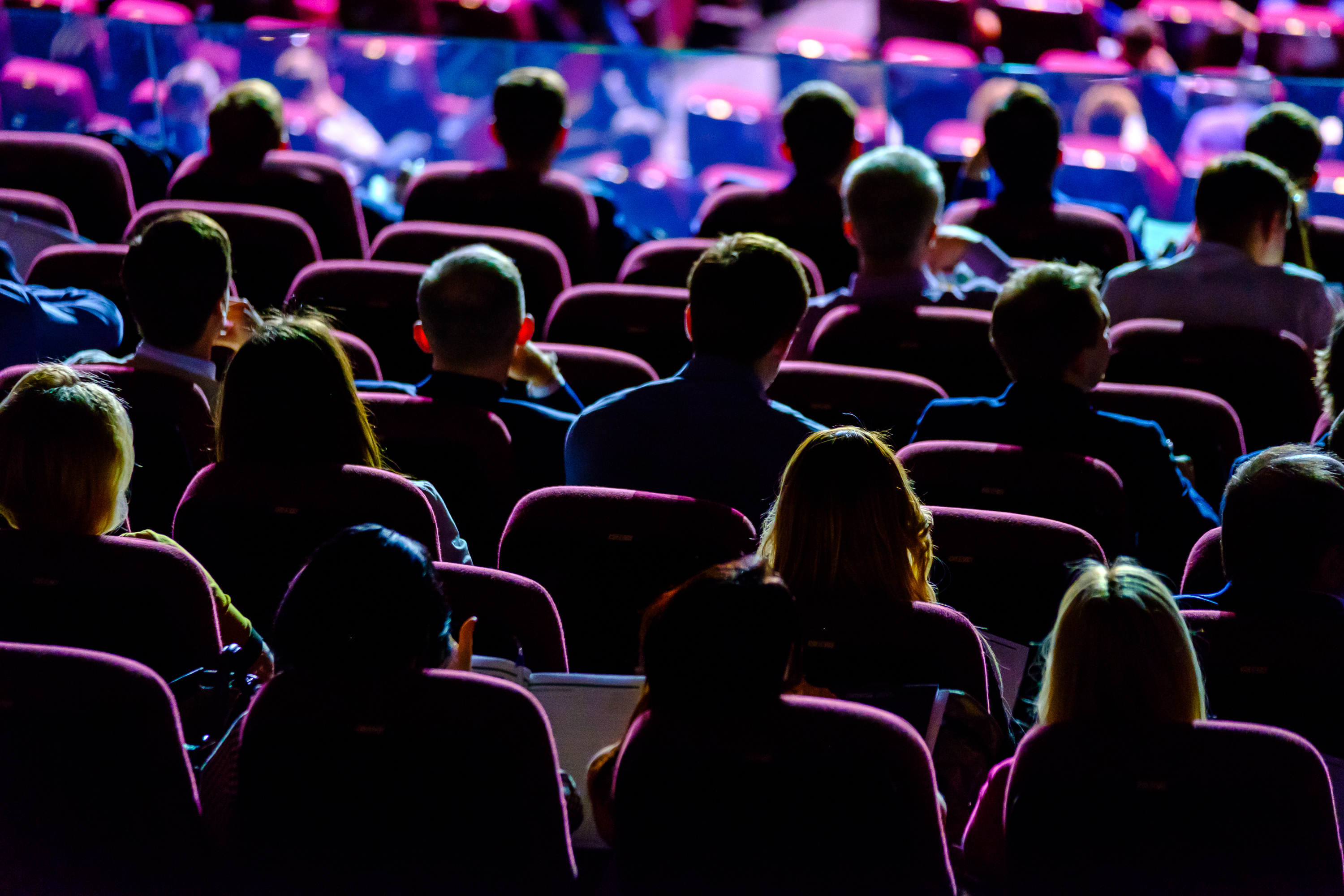 a_crowd_looking_at_a_stage